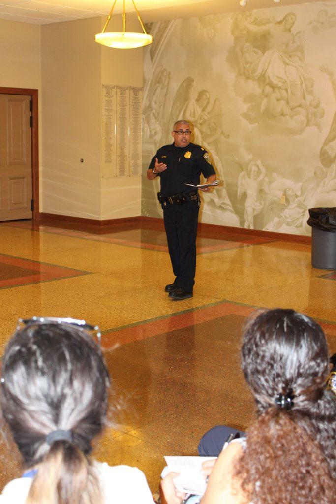 Police Captain Ramirez addresses group.