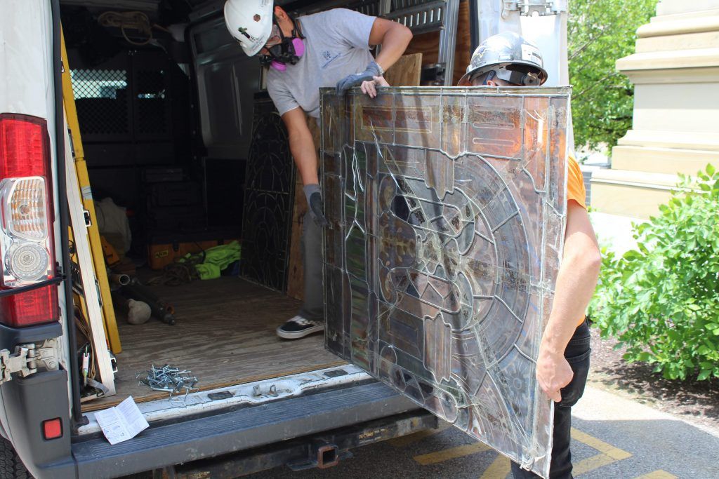 Loading the stained glass on to the van.