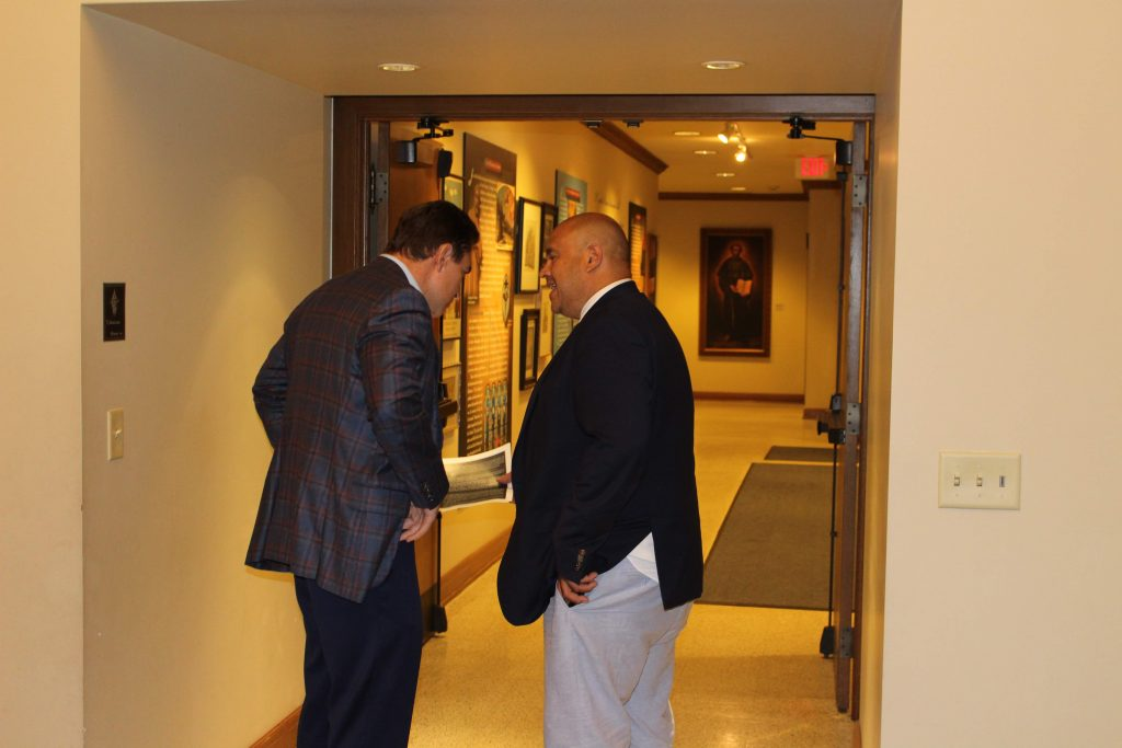 Alderman Perez chats up Alderman Zielinski before the District 14 councilman heads out.